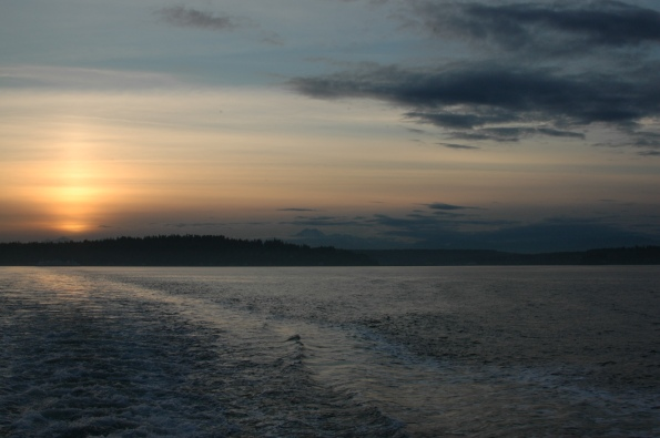 Sunset over Bainbridge Island and the Olympic Mountains, with our partner ferry approaching Eagle Harbor