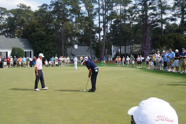 Steve Stricker giving Phil Mickelson a putting tip, on the practice green at Augusta